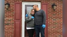 Amanda Stone and Scott Maraldo are in front of the house they bought that Scott has never visited.