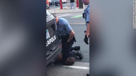 4 Minneapolis police fired after video showing a man kneeling on the neck of a black man who later died