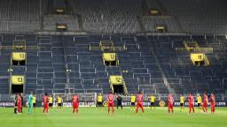 In eerie silence, Bayern Munich close in on Bundesliga title with win over Dortmund