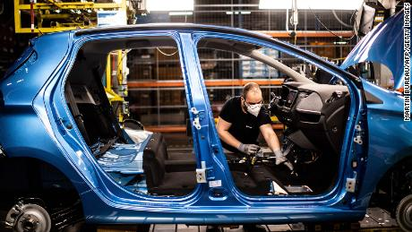 An assembly line near Paris that produces both the electric Renault Zoe and the hybrid Nissan Micra.