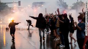 Tear gas is fired as protesters clash with police while demonstrating against the death of George Floyd outside a police precinct on May 26, 2020 in Minneapolis, Minnesota