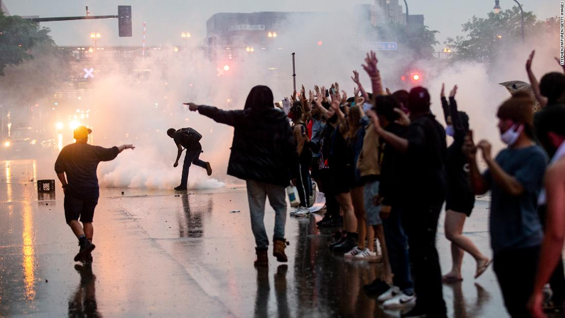 Tear gas is fired as protesters clash with police while demonstrating outside the Third Precinct in Minneapolis.