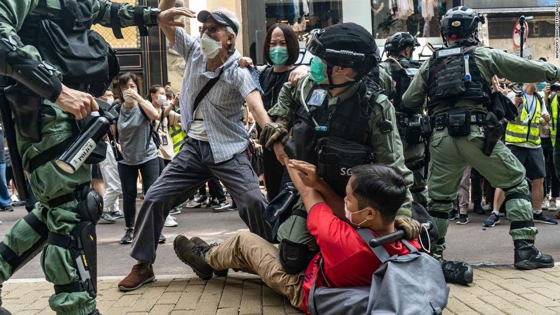 Pro-democracy protesters scuffle with police on May 27.