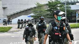 Hong Kong police surround legislature ahead of protests over national anthem bill
