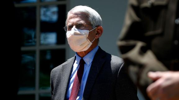Director of the National Institute of Allergy and Infectious Diseases Dr. Anthony Fauci listens as President Donald Trump speaks about the coronavirus in the Rose Garden of the White House, Friday, May 15, 2020, in Washington. (AP Photo/Alex Brandon)