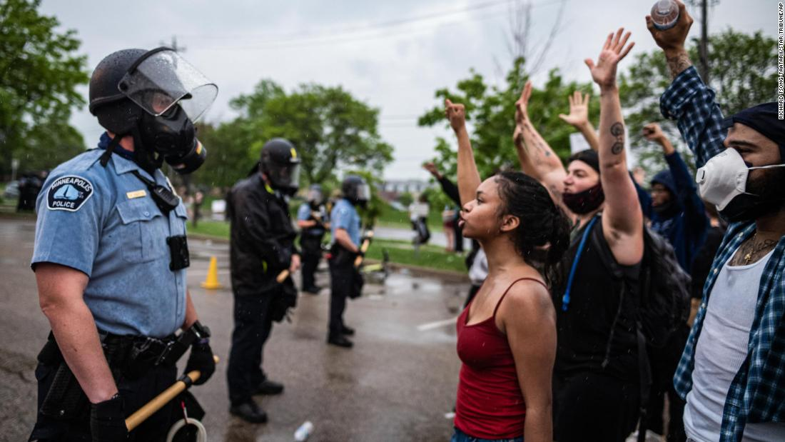 Protesters and police face off during a rally Tuesday in Minneapolis.