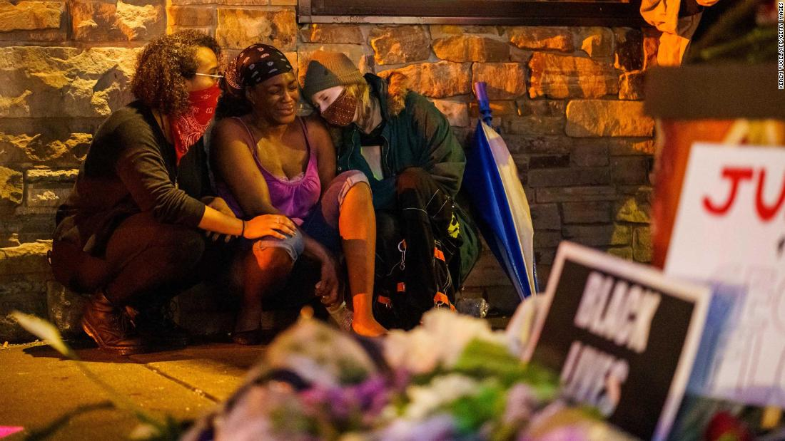 Shawanda Hill, center, the girlfriend of Floyd, reacts Tuesday in Minneapolis near the spot where he died.