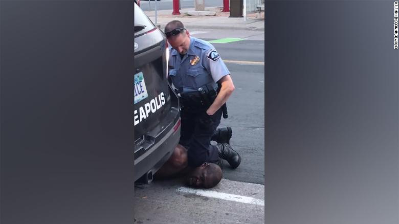Cell phone video shows an officer with a knee on George Floyd's neck on Monday evening.