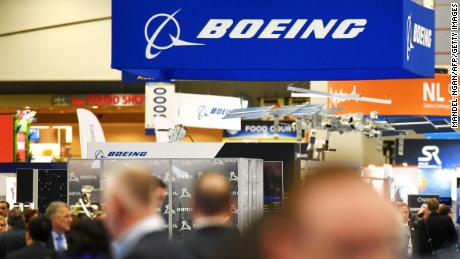 The Boeing logo is seen at its stand during the the 70th annual International Astronautical Congress at the Walter E. Washington Convention Center in Washington, DC on October 22, 2019. (Photo by MANDEL NGAN / AFP) (Photo by MANDEL NGAN/AFP via Getty Images)