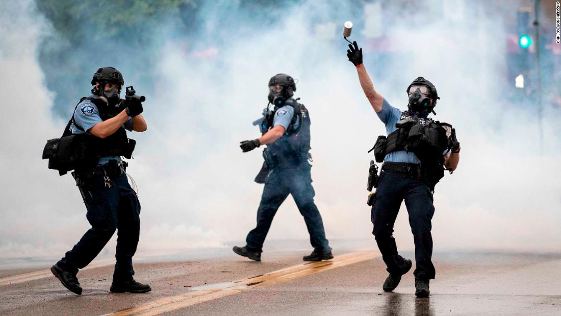 A police officer throws a tear gas canister toward protesters during a rally in Minneapolis on Wednesday.