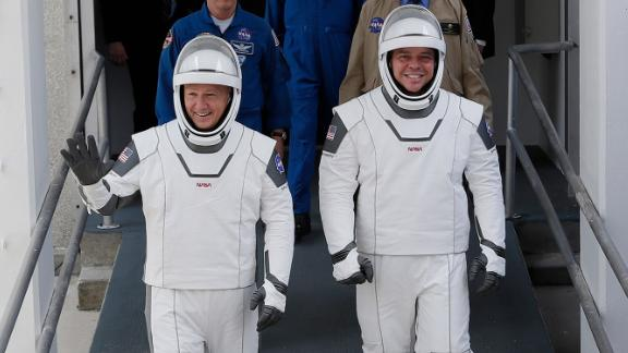 Hurley and Behnken walk out of the Neil Armstrong Operations and Checkout Building.