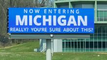 Two Indiana signs suggest that people think twice about going to Michigan during the pandemic