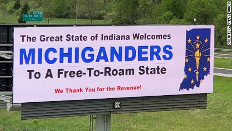 Two Indiana billboards suggest people think twice about going to Michigan during the pandemic