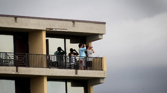 Spectators look out from a hotel balcony in Cocoa Beach, Florida, on May 27.