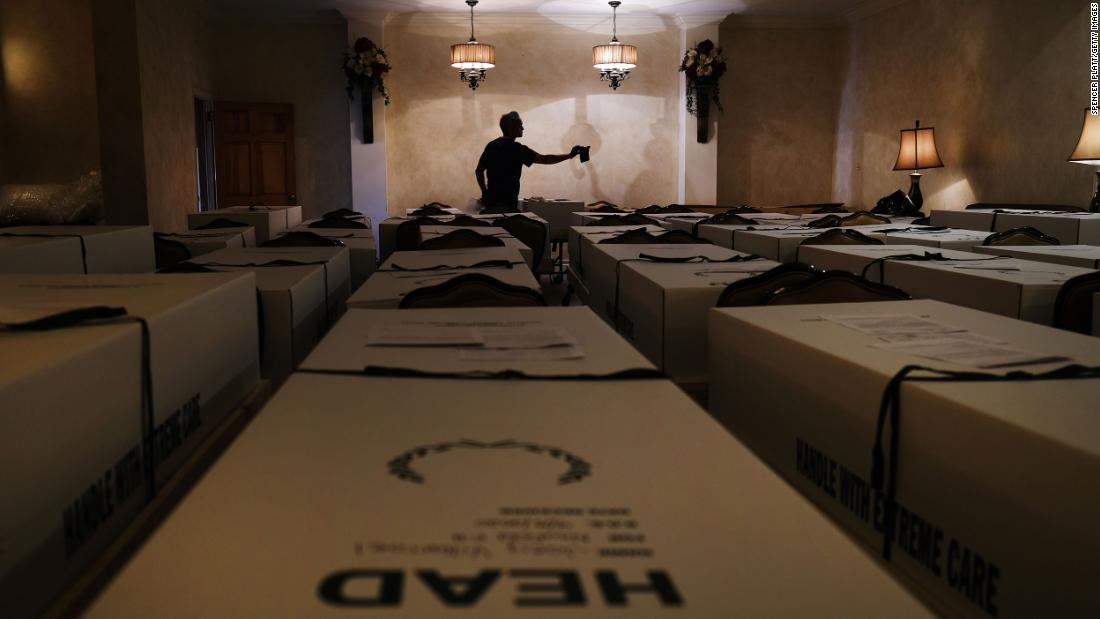Omar Rodriguez organizes caskets at the Gerard Neufeld Funeral Home in New York on April 22. The funeral home in Queens has been overwhelmed by the pandemic.
