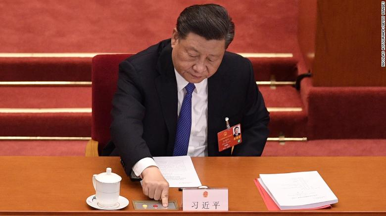 Chinese President Xi Jinping votes on a proposal to draft a security law on Hong Kong during the closing session of the National People's Congress at the Great Hall of the People in Beijing on May 28, 2020.