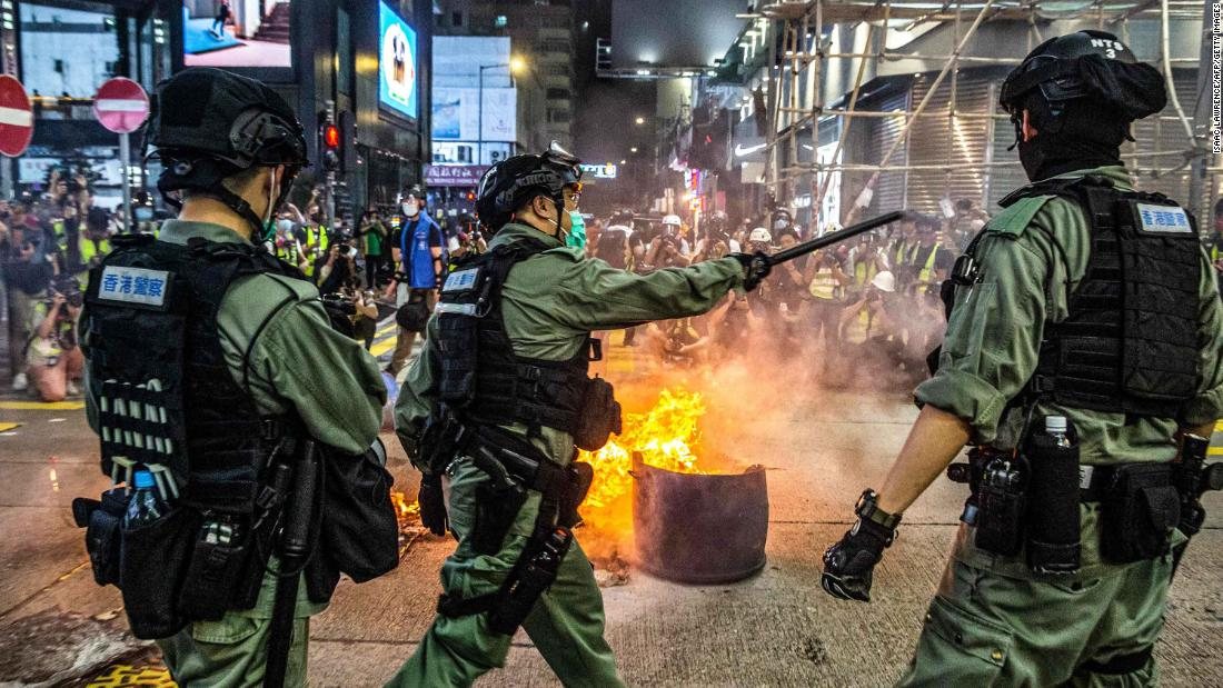 Police try to deter pro-democracy protesters from blocking roads in the Mong Kok district  on May 27.