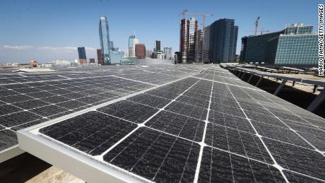 Solar panels are mounted atop the roof of the Los Angeles Convention Center on September 5, 2018 in Los Angeles, California. The solar array of 6,228 panels is expected to generate 3.4 million kilowatt hours of electricity per year. A landmark bill committing the state to 100 percent clean energy by 2045 may be signed by California Governor Jerry Brown.  (Photo by Mario Tama/Getty Images)