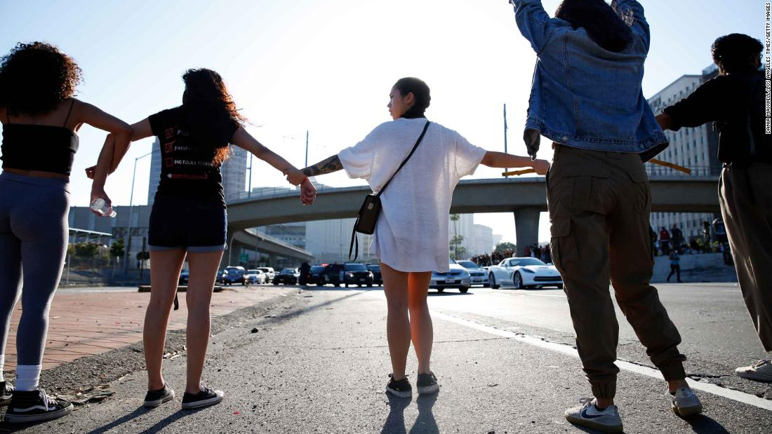 People join hands across a freeway in Los Angeles during a Black Lives Matter protest on Wednesday.