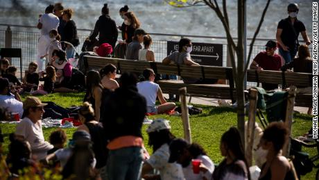 People relax at a park in New York on May 3, 2020.