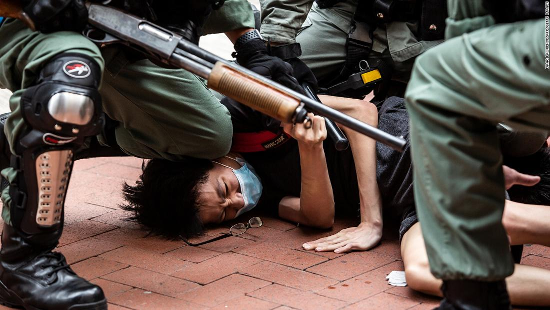 A pro-democracy protester is detained by police on May 24.