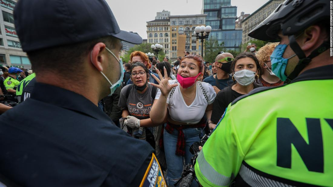 "Protesters speak to cops during a ""Black Lives Matter"" demonstration in New York City on Thursday."