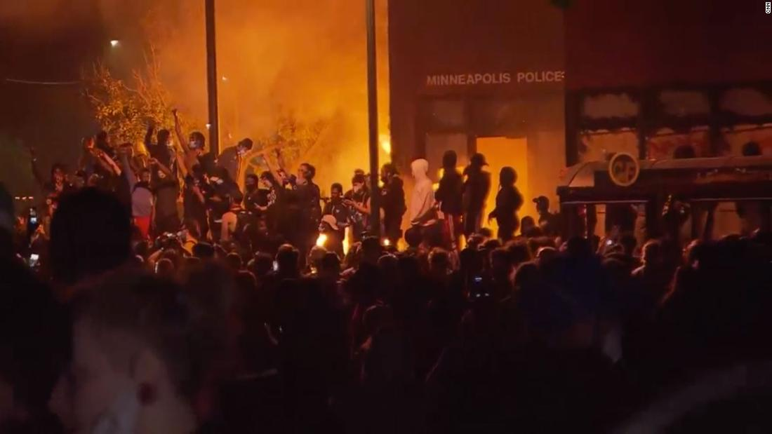 A Minneapolis police precinct is burning during a second night of protests over the death of George Floyd