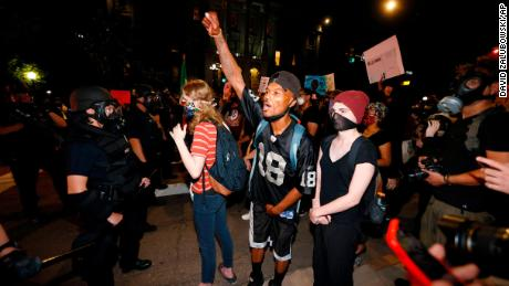 Why black and white protesters say they're angry