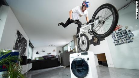 "Wibmer describes riding his bike at home as a ""weird situation."""