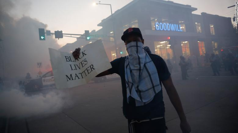 "A demonstrator displays a ""Black Lives Matter"" sign Thursday, May 28, 2020, in St. Paul, Minnesota."