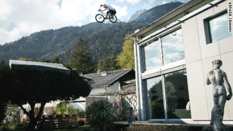 Wibmer jumps from the roof of his house onto a tree.