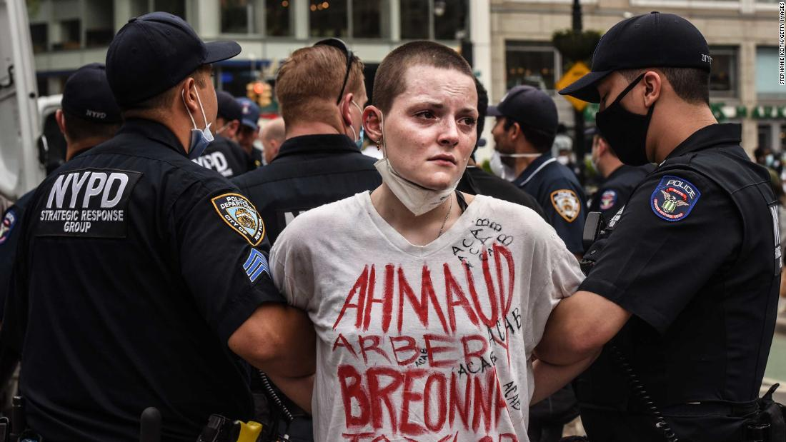 A protester is detained by police during a rally in Union Square in New York City on Thursday.