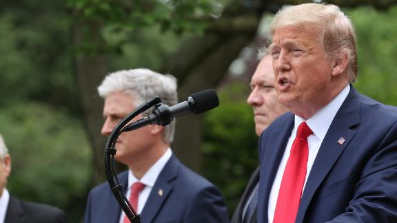 WASHINGTON, DC - MAY 29: U.S. President Donald Trump is flanked by administration officials while speaking about U.S. relations with China in the Rose Garden at the White House May 29, 2020 in Washington, DC. President Trump did not take questions regarding the current situation in Minneapolis following the death of George Floyd and todays arrest of Derek Chauvin the former Minneapolis police officer who knelt on Floyd's neck for an extended time causing him to die.   (Photo by Win McNamee/Getty Images)