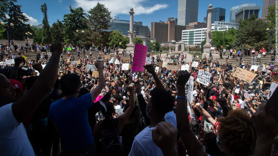 Protesters chant in Civic Center Park during a protest on Friday in Denver.