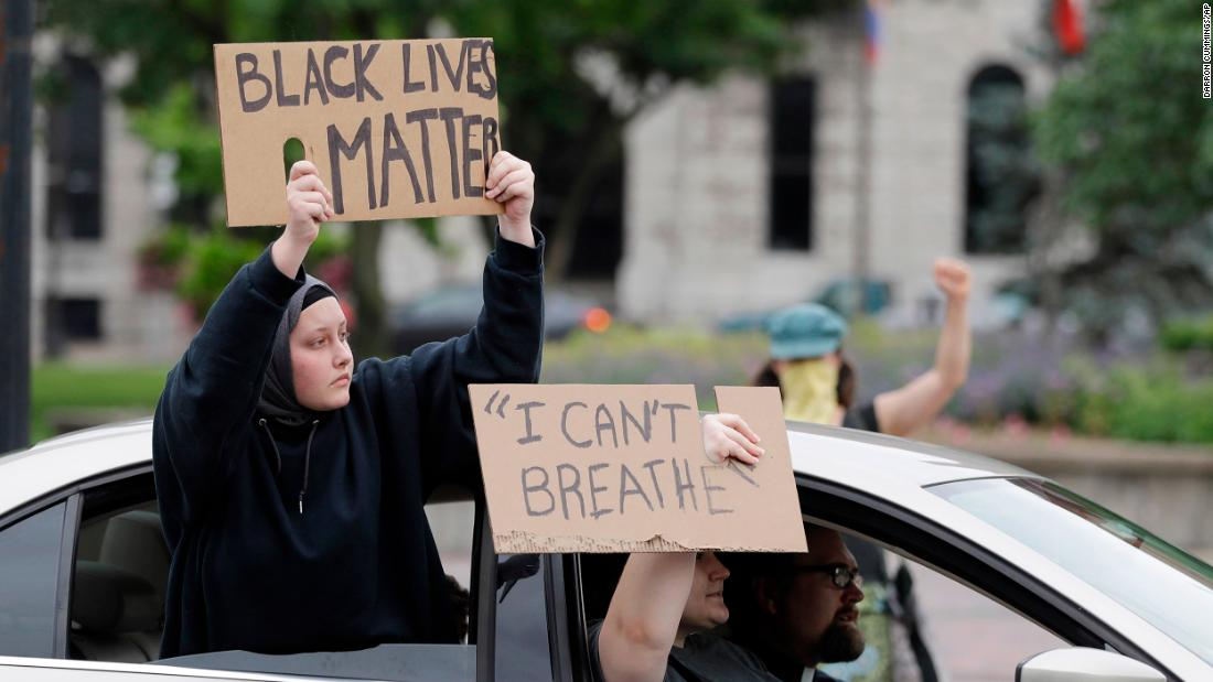 "Protesters ride in cars in a demonstration in Louisville, Kentucky, over the deaths of Floyd and Breonna Taylor, an EMT who was <a href=""https://www.cnn.com/2020/05/21/us/breonna-taylor-death-police-changes-trnd/index.html"" target=""_blank"">killed in a police shooting</a> earlier this year in Louisville."