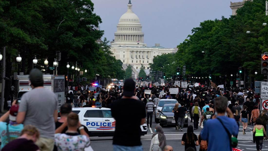 Demonstrators walk along Pennsylvania Avenue in Washington during a protest Friday.