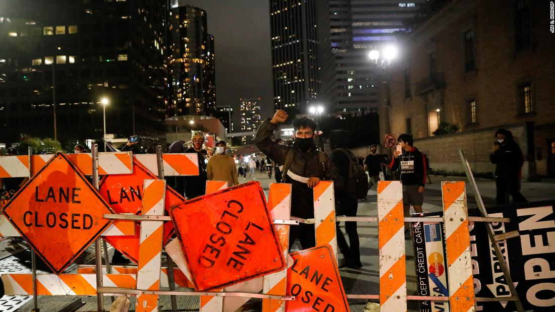 Protesters block a street with signs in Los Angeles on Friday.