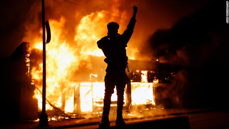 A check-cashing business burns during protests in Minneapolis on Friday.