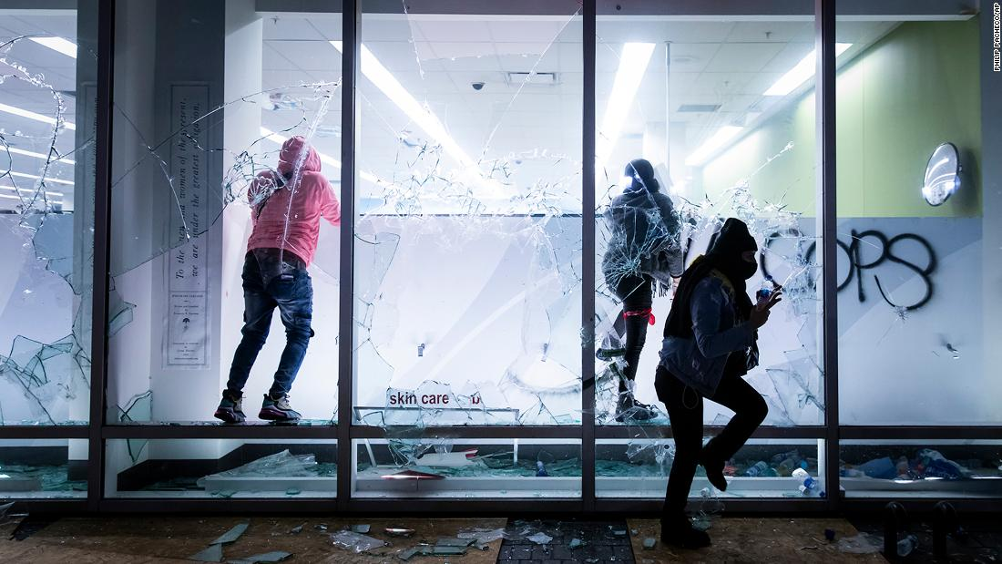 People vandalize a Walgreens store Friday during protests in Oakland, California.