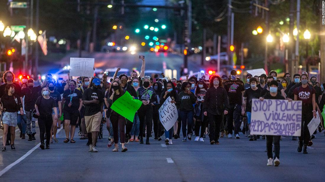 Protesters calling for an end to police violence walk through downtown Lexington, Kentucky, on Friday.