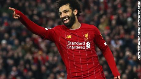 Mohamed Salah of Liverpool celebrates after scoring his team's fourth goal during the Premier League match between Liverpool FC and Southampton FC at Anfield on February 01, 2020 in Liverpool, United Kingdom. (Photo by Julian Finney/Getty Images)