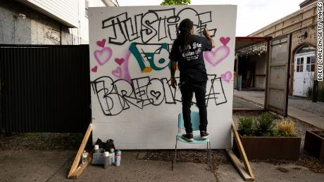 Grafitti artist Resko painting a mural in honor of Breonna Taylor for a protest march held May 29, 2020 in Louisville, Kentucky.