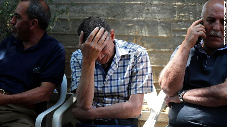 The father of Eyad Rawhi Al-Halaq mourns his son's death.