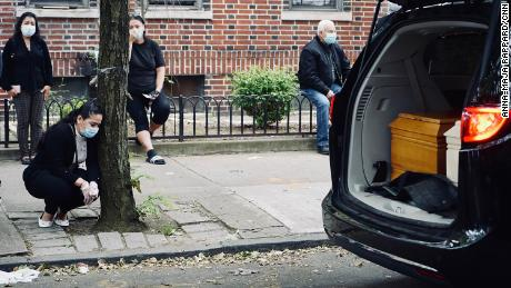 Friends and family wore facemasks and tried to socially distance as they bid farewell to Carlos and Lordes Coronel. The two coffins laid side-by-side in the back of a van that stopped in front their family home in Brooklyn, New York.