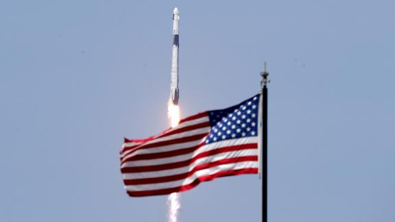 An American flag flies as the SpaceX rocket lifts off on May 30.