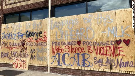The Jackalope Tattoo boarded up the business and spray painted slogans supporting  the protesters.