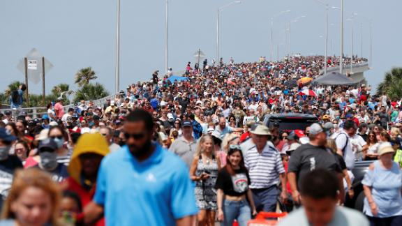 Huge crowds gathered to watch the launch from Titusville, across from Kennedy Space Center in Cape Canaveral, Florida.