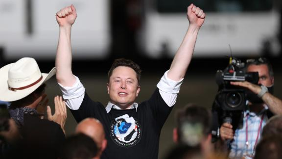 """SpaceX founder <a href=""""https://www.cnn.com/2020/05/13/us/gallery/elon-musk/index.html"""" target=""""_blank"""">Elon Musk</a> celebrates after the successful launch."""