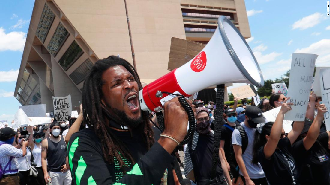 Protesters chant outside Dallas City Hall on Saturday, May 30.