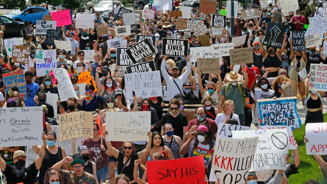 Protesters march near the Salt Lake City Police Department on Saturday in Salt Lake City.
